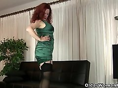 American milf Andi James dips her fingers into her ass