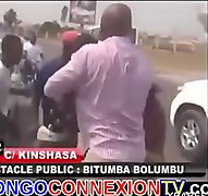 Congo lady fights topless on high way