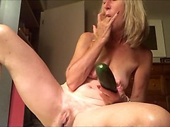 wild beaver kamster devours cucumber in domestic habitat