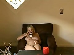 busty milf masturbating on a couch while watching porn in the afternoon