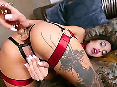 Naughty latina chick Roksy masturbates her ass with a glass dildo in front of Jean-Marie Corda