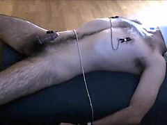 Male tied, edged with vibrator and nipple clamps. Orgasm denial.
