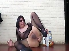 Crossdresser fisting in dark fishnets