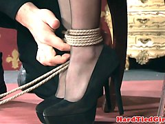 bdsm sub tied to table toyed using vibrator