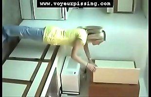 www.voyeurpissing.com - Amateur blonde filmed pissing inside a cup by her girlfriend