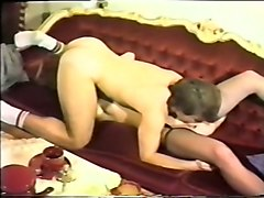 curly haired slender white lady on the couch blows dick in 69 style position