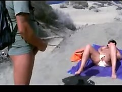 Mutual masturbation on the public beach
