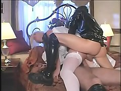 Devious man  deliver his young charming wife Missy Monroe into the filthy hands of couple latex maniacs in breathing gas masks