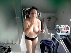 Nice mature takes a shower after a workout