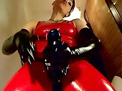 latex mistress with huge strapon !