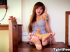 ladyboy footlover teasing with red toenails