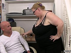 busty lady boss in glasses rides his dick