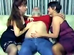 Daddy Bear Sucked by Two Mature Bitches