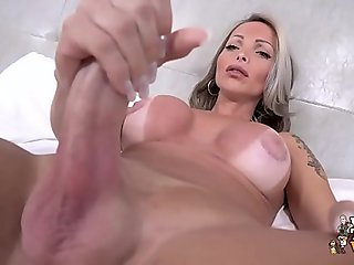 Carla Novaes is back with a hard cock and lots of thick cum