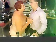 Elderly woman doing a striptease