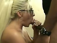 Blonde bitch sucks hard black cock and gets pussy fucked roughly by black horny guy