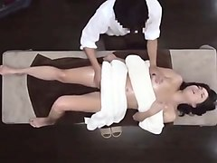 Striking Oriental babe gets nailed hard on the massage table