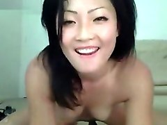 Brunette Ayisa playing with silicone phallus