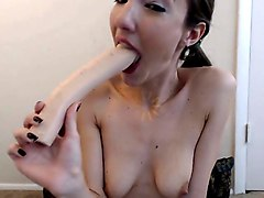 she getting fuck on her pussy and mouth with dildo