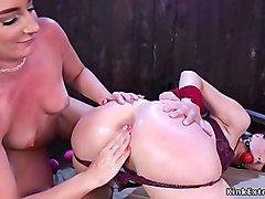 Gagged lesbian spanked and anal plugged
