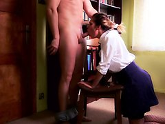 Naughty schoolgirl in uniform takes a cock down her throat