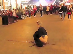 Brave blonde urinates on the middle of the crowded street!