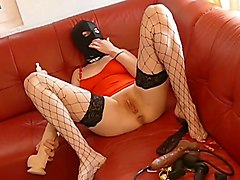 masked bitch in fishnet stockings masturbating with huge sex toy