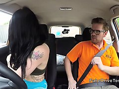 brunette student in hotpants has driving class