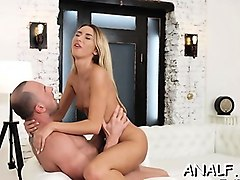 appealing gal holds cock in the ass and screams of enjoyment