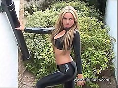 Blonde latex babe Amandas outdoor high heel boots and tight rubber-latex fetish wear
